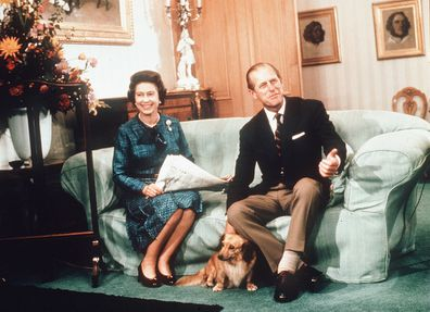 Queen Elizabeth and Prince Philip with their dogs