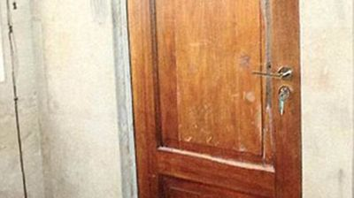 Pistorius shot Steenkamp four times through this toilet cubicle door, hitting her in the hip, arm and head.