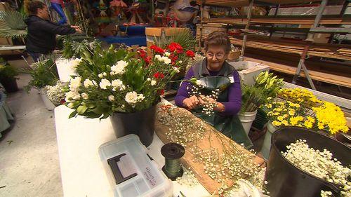 Blaire Ringwaldt's team preparing dozens of bouquets.