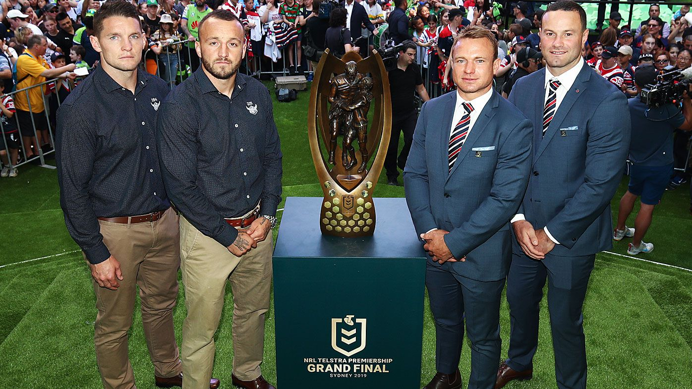 Jarrod Croker and Josh Hodgson of the Raiders & Jake Friend and Boyd Cordner of the Roosters pose with the Provan-Summons Trophy