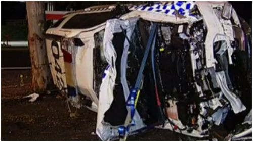 Woman seriously injured after collision with police car in Geelong