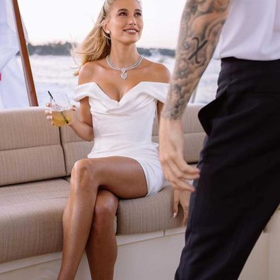 Hailey Bieber on steamboat heading for rehearsal dinner in South Carolina.