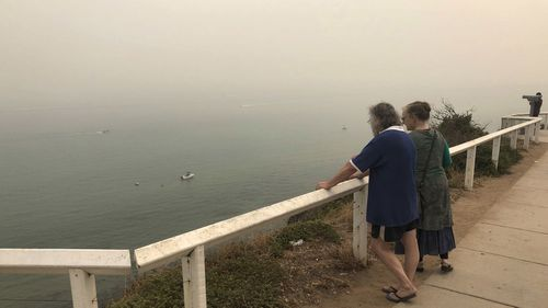 Smoke haze from bushfires is seen at Frankston Beach in Melbourne, Friday, January 3, 2020.