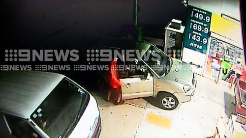 A man is seen looking inside the car to check if the keys are in the ignition before jumping in. Picture: 9NEWS