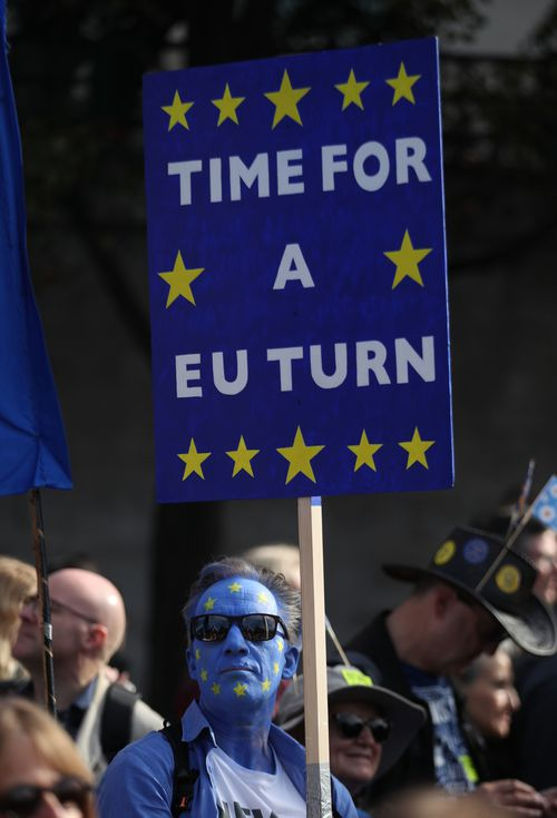 """Marchers chanted """"People's vote!"""" and brandished signs with slogans like """"bollocks to Brexit"""", """"the wrexiteers"""" and """"Brexit stole my future""""."""