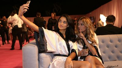 Aussie babe Shanina Shaik snaps a selfie with fellow model Kate Grigorieva before the Victoria's Secret Fashion Show in London. (AAP)