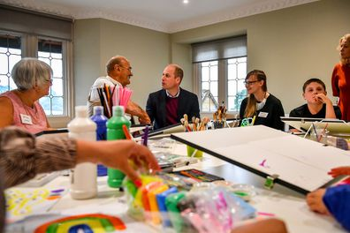 Prince William with Richard Baldwin in an art therapy session.