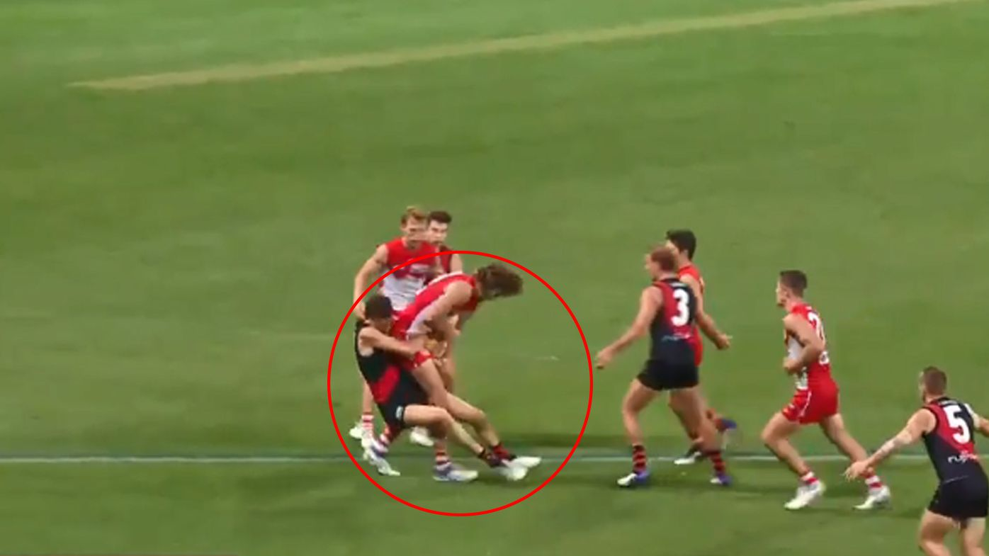 Controversial holding the ball no-call splits opinions in Sydney-Essendon thriller