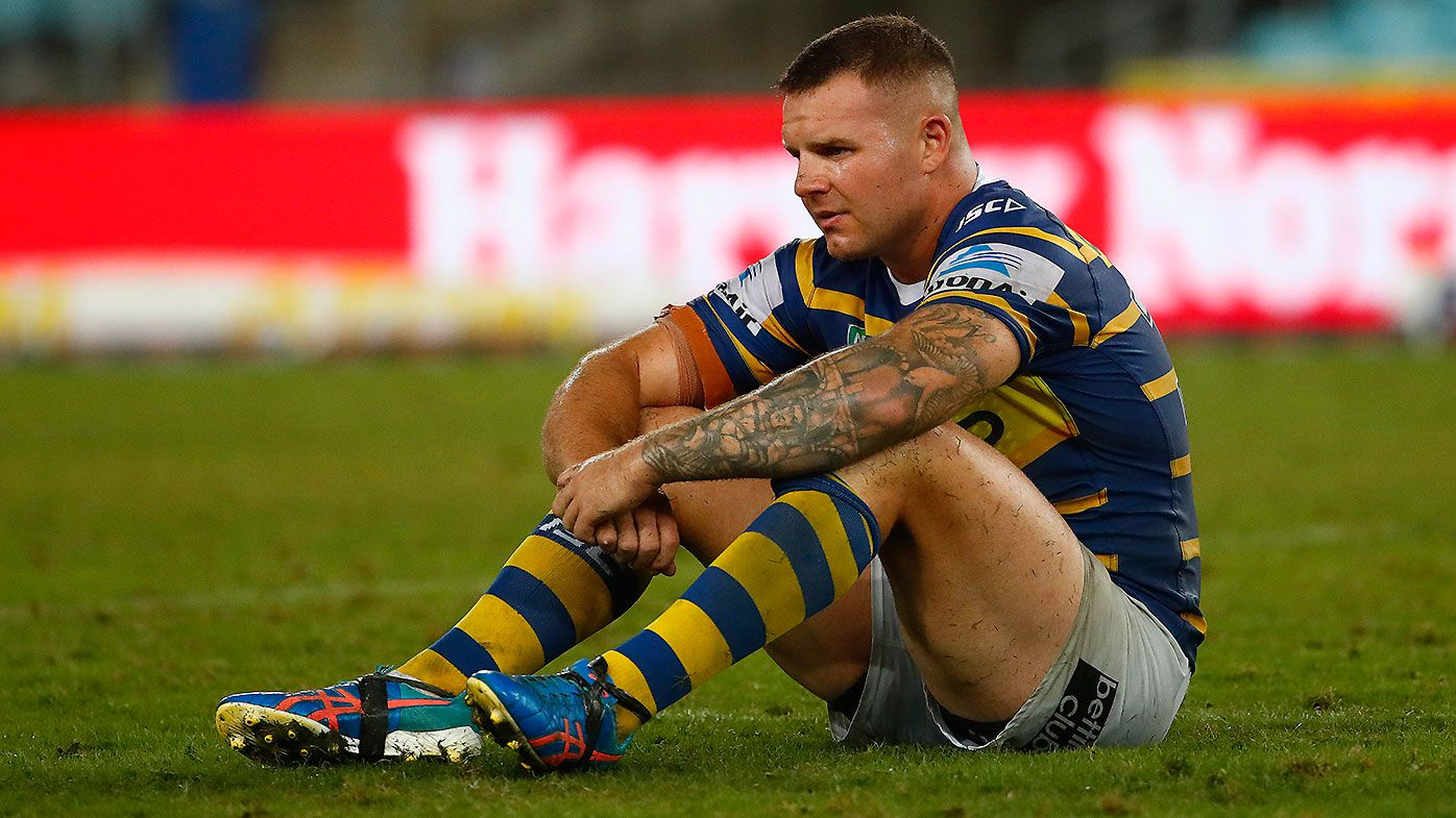 Nathan Brown of the Eels sits on the field after losing