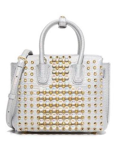 """<p>Top tote</p> <p>MCM mini pearl stud tote, $870 at <strong><a href=""""https://www.shopbop.com/mini-pearl-studs-tote-mcm/vp/v=1/1546547584.htm?fm=search-viewall-shopbysize&os=false"""" target=""""_blank"""">Shopbop<br> </a></strong></p>"""