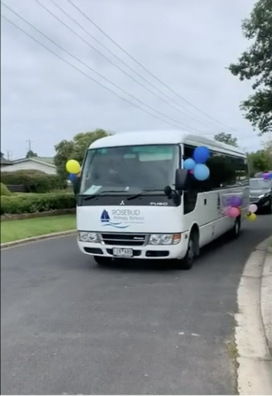 Decked out in balloons, and a loudspeaker, a convey of vehicles drove past students' homes.