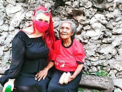 Amanda sitting with an elderly woman