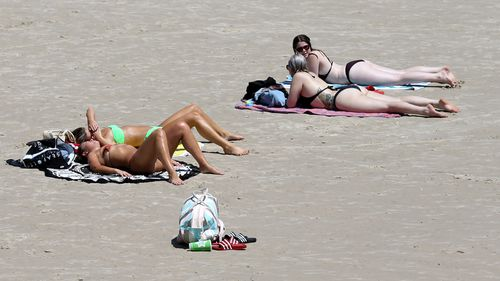Beachgoers are being warned to avoid the hottest part of the day and keep hydrated.