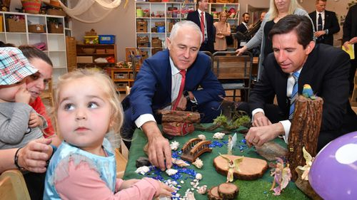 Prime Minister Malcolm Turnbull and Minister for Education Simon Birmingham visit a childcare centre. (AAP)