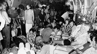 Hundreds of victims left homeless by the cyclone are evacuated on military planes. (AAP)