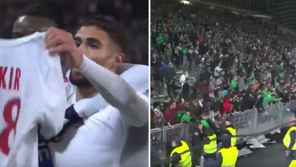Angry fans disrupt Lyon Ligue 1 derby win over bitter rivals Saint-Etienne