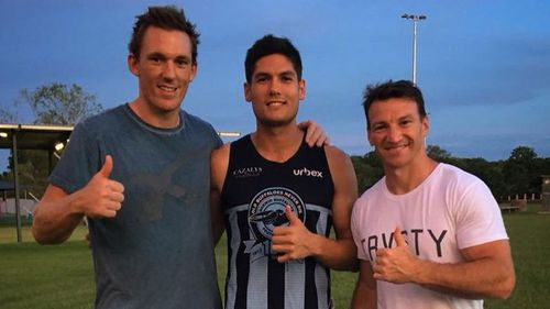 Martin-Page with former AFL players Drew Petrie and Brent Harvey.