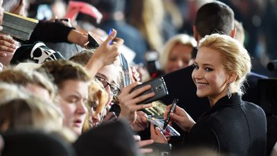 J-Law signs autographs at the Berlin Premiere for The Hunger Games:Mockingjay - Part 2, the final installment of the series.