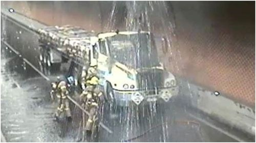 MFB crews work to clear the tunnel.