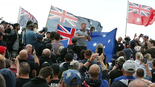 Convicted criminal Blair Cottrell (centre, with megaphone) was one of the organisers.