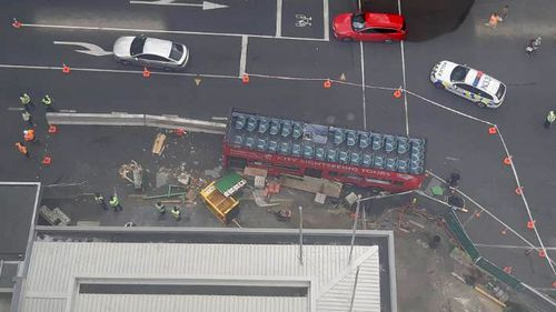 A bus has crashed into the City Rail Link construction site for the planned Aotea Station, injuring three people