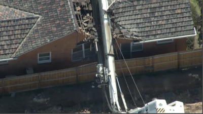 Elderly couple's lucky escape after drill rig falls onto home