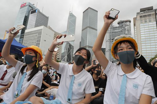 Students wear helmets and face masks during a protest in Hong Kong, on Monday, Sept. 2, 2019.  (AP Photo/Kin Cheung)