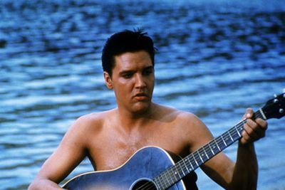 Elvis plays an ex-soldier-turned tour guide in this cheesy classic - now that's one guy we'd <i>love</i> to have show us around Hawaii!
