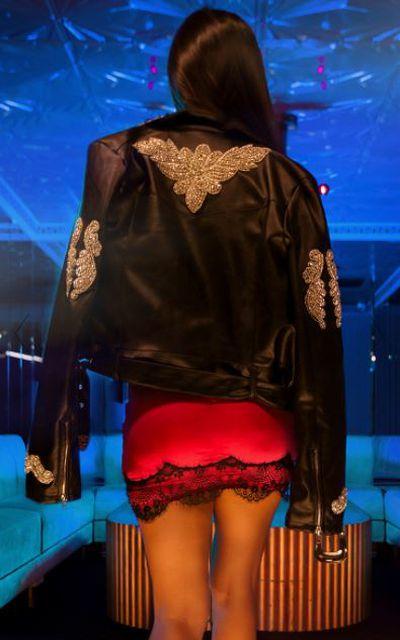 """<a href=""""https://www.prettylittlething.com.au/black-embellished-applique-detail-pu-biker-jacket.html"""" target=""""_blank"""" draggable=""""false"""">Black embellished applique detail PU biker jacket, $150.</a>"""