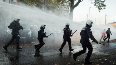 Police fired water cannons and tear gas on demonstrators. (AAP)