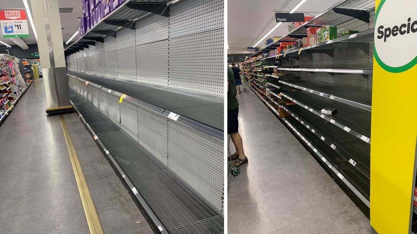 Shoppers empty supermarket shelves amid rush for essentials