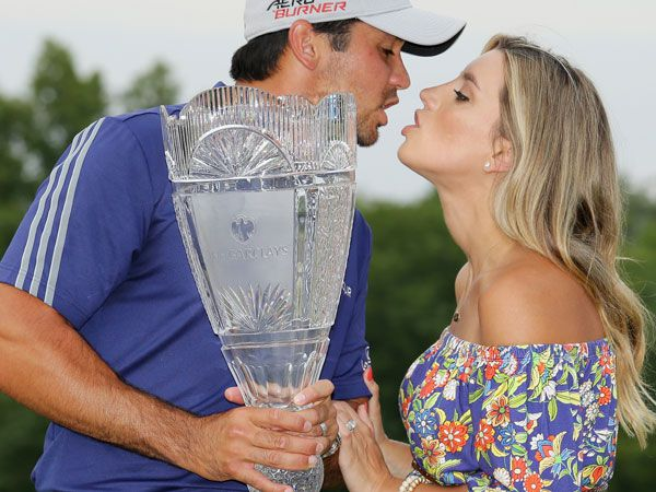 Jason Day kisses his wife after receiving the Barclays trophy. (AFP)