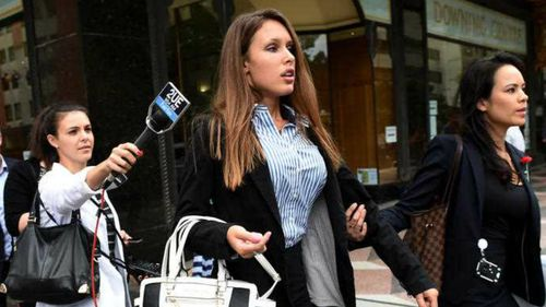 Sophia Tilley, the girlfriend of Margaret Cunneen's son, emerges from the Downing Centre courts. (AAP)