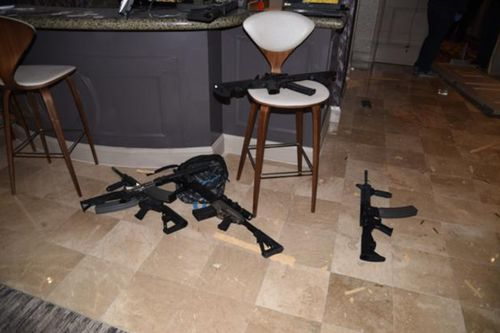 A number of guns can be seen littering the floor of the hotel room. Image: Las Vegas Metropolitan Police Department