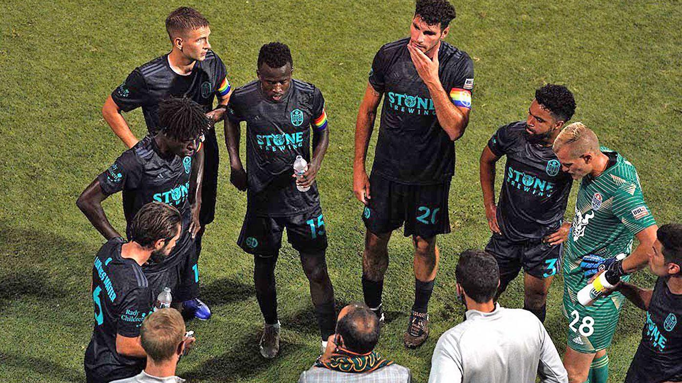 San Diego Loyal players meet at half-time