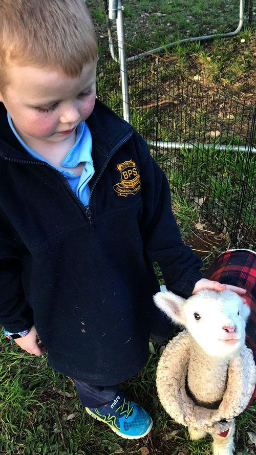 Leanne Heffernan's son Nash takes care of one baby.