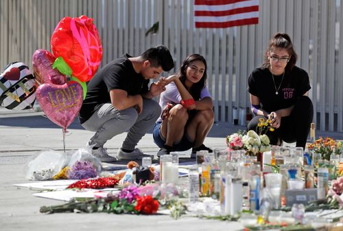 Mourners lay tributes to those that lost their lives while watching the Route 91 Music Festival.