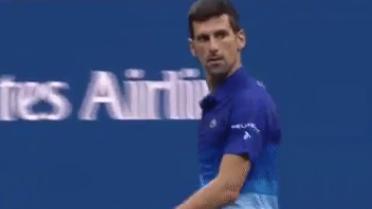 Novak Djokovic stares down heckling fan, complains to umpire in breezy win