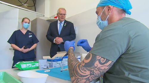 Scott Morrison meets medics as he visited the new Sydney vaccine centre.