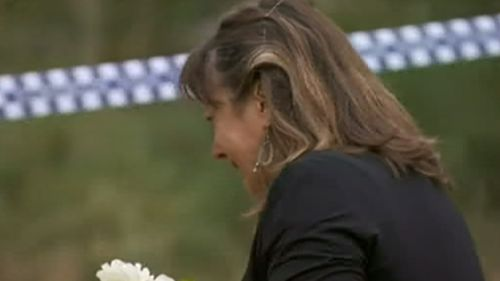 A woman was seen crying near where the body was found. (9NEWS)