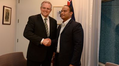 <p>Scott Morrison shakes hands with the Foreign Minister of Nauru David Adeang during a meeting at Parliament House in Canberra on September 24, 2013.</p>