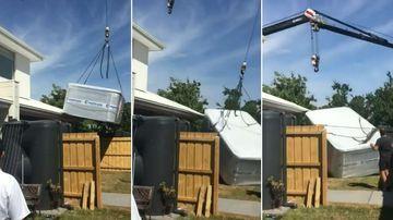 Moment crane crashes into home