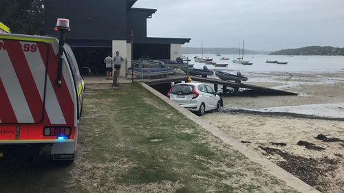 Couple in car left hanging over ledge in Sydney