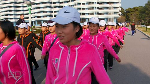 Young girls learning coordinated marching