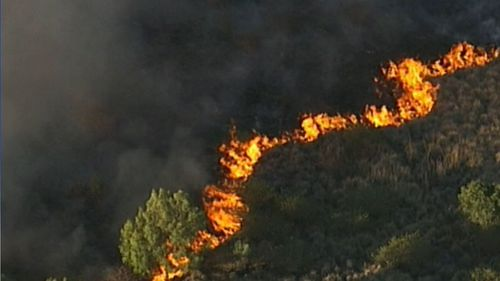 The fire near Gympie was not a threat to homes but being monitored by firefighters overnight.