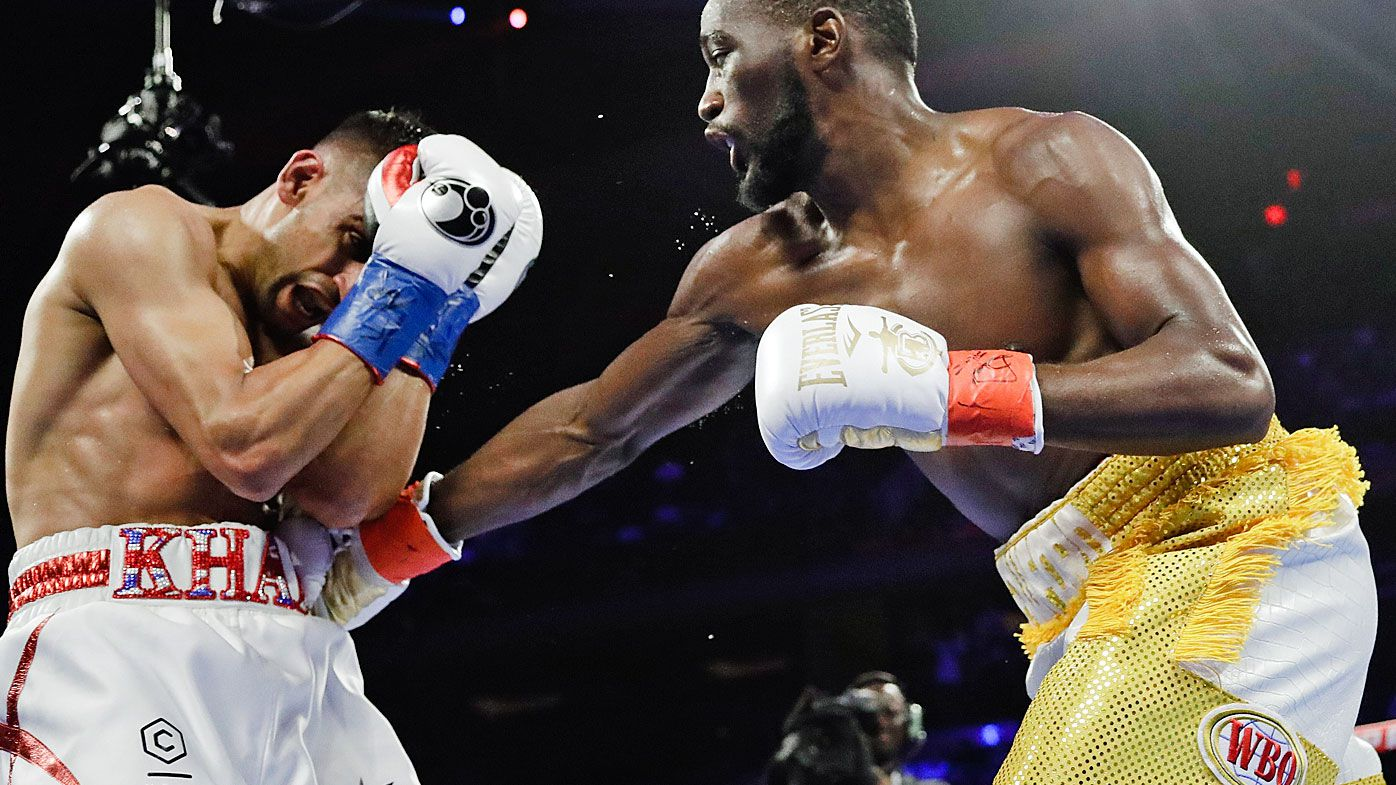 Terence Crawford beats Amir Khan by TKO after 'low blow' controversy in WBO welterweight title fight