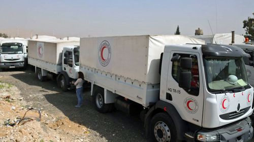 The convoy arrives in rebel-held parts of Damascus. (Photo: AP).