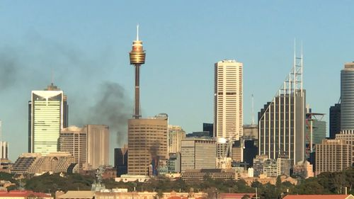 Black smoke can be seen billowing across the Sydney sky. Picture: 9NEWS
