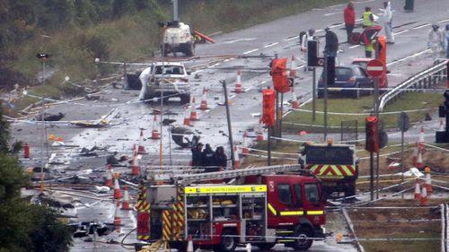 Emergency crews at the crash scene at Shoreham airport in 2015.