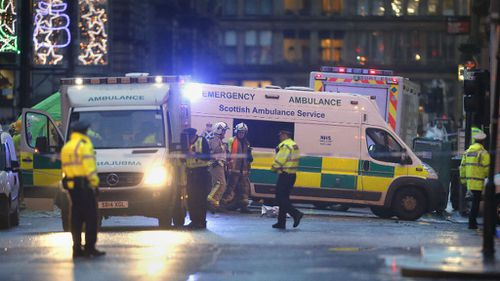 Emergency services at Glasgow's George Square after a garbage truck crashed into pedestrians. (AAP)